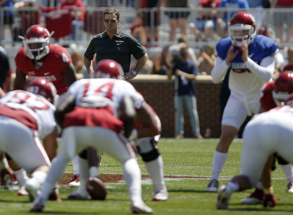 Photo -  University of Oklahoma coach Bob Stoops watches during his team's spring game on April 8. [PHOTO BY BRYAN TERRY, THE OKLAHOMAN]