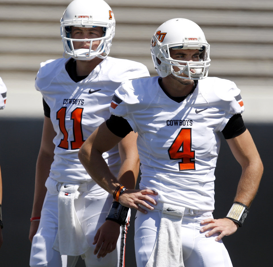 OSU\'s Wes Lunt, left, and J.W. Walsh stand stand beside each other before Oklahoma State\'s spring football game at Boone Pickens Stadium in Stillwater, Okla., Saturday, April 21, 2012. Photo by Bryan Terry, The Oklahoman