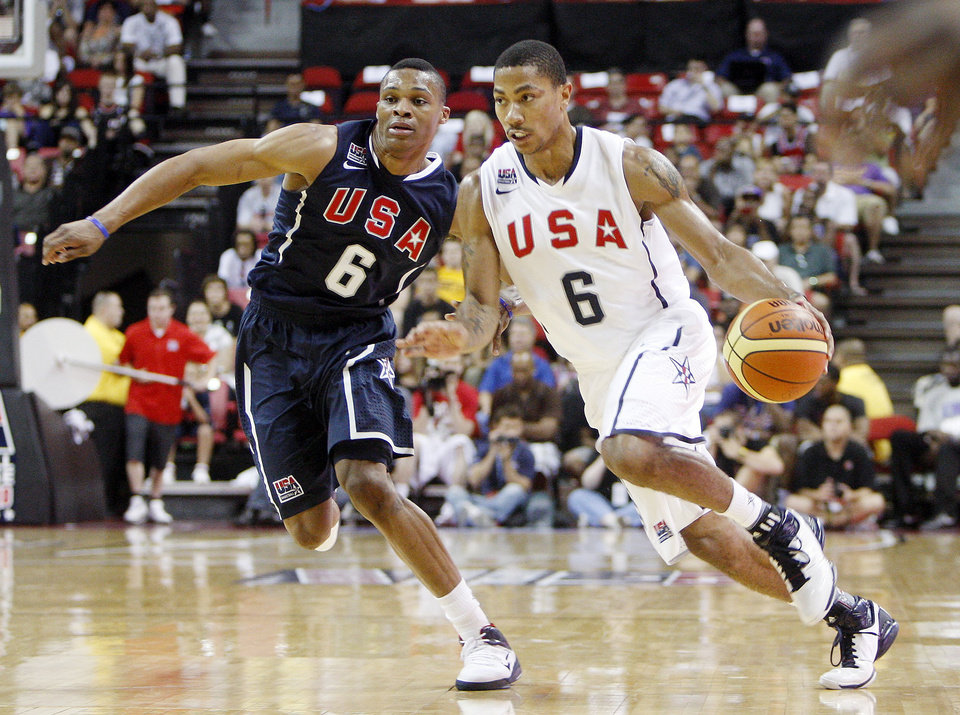 Russell Westbrook, left, covers Derrick Rose, right, during a USA Basketball men\'s national team exhibition game on July 24. AP PHOTO