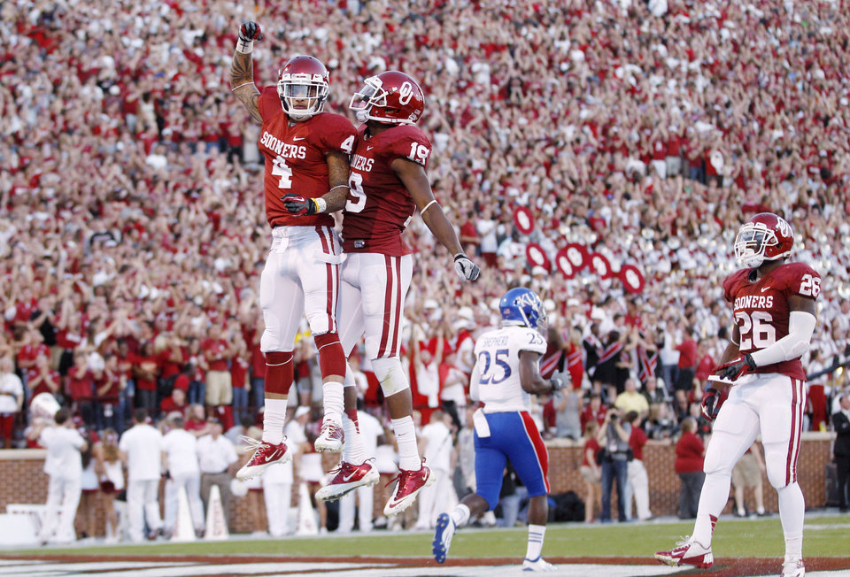 Oklahoma wide receiver Kenny Stills (4) and wide receiver Justin Brown (19) celebrate following Stills' touchdown against Kansas in the first quarter of an NCAA college football game in Norman, Okla., Saturday, Oct. 20, 2012. (AP Photo/Sue Ogrocki)