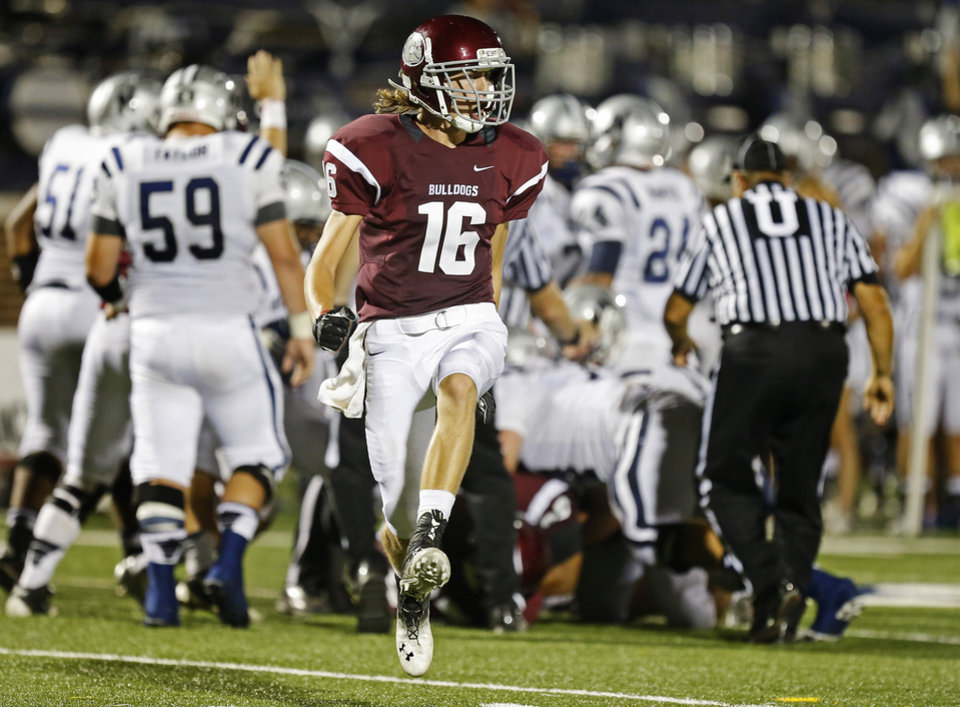 Photo - Edmond Memorial's Tasden Ingram celebrates after an Edmond Memorial fumble recovery against Edmond North during s high school football game at Wantland Stadium in Edmond, Friday, September 6, 2013. Photo by Bryan Terry, The Oklahoman