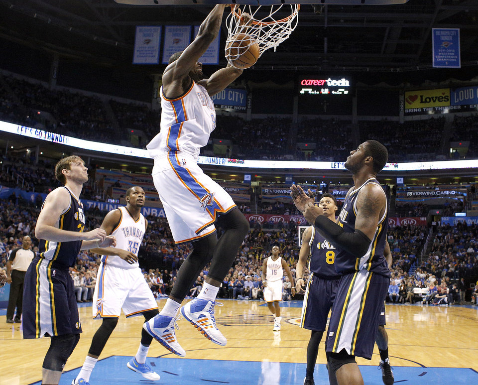 Photo - Oklahoma City's Serge Ibaka (9) dunks the ball during the NBA game between the Oklahoma City Thunder and the Utah Jazz at the Chesapeake Energy Arena, Sunday, Nov. 24, 2013. Photo by Sarah Phipps, The Oklahoman