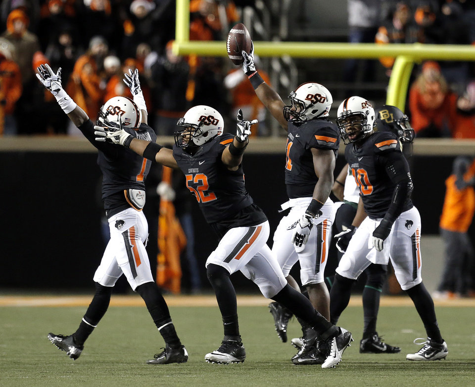 Oklahoma State's Shaun Lewis (11) celebrate a fumble recovery in the third quarter during a college football game between the Oklahoma State University Cowboys (OSU) and the Baylor University Bears (BU) at Boone Pickens Stadium in Stillwater, Okla., Saturday, Nov. 23, 2013. Photo by Sarah Phipps, The Oklahoman