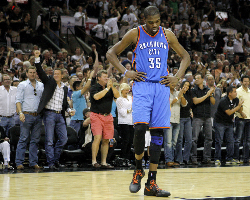 Oklahoma City's Kevin Durant (35) reacts as the crowd cheers during Game 1 of the Western Conference Finals between the Oklahoma City Thunder and the San Antonio Spurs in the NBA playoffs at the AT&T Center in San Antonio, Texas, Sunday, May 27, 2012. Photo by Bryan Terry, The Oklahoman