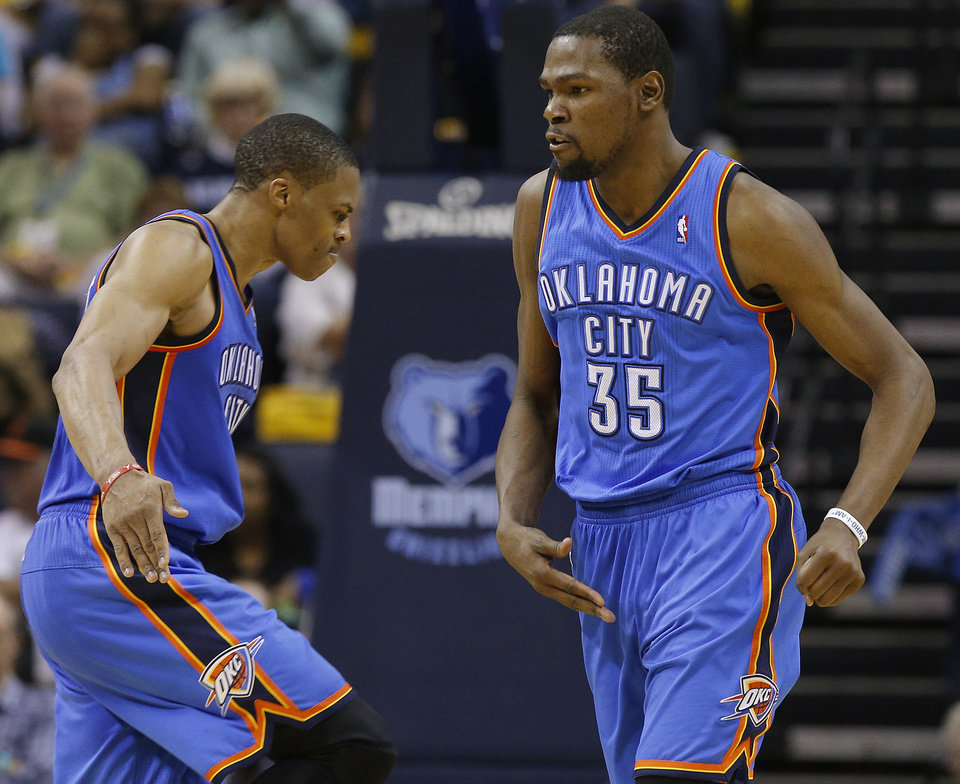 Photo - Oklahoma City's Kevin Durant (35) and Russell Westbrook (0) celebrate after a dunk during Game 6 in the first round of the NBA playoffs between the Oklahoma City Thunder and the Memphis Grizzlies at FedExForum in Memphis, Tenn., Thursday, May 1, 2014. Oklahoma City won 104-84. Photo by Bryan Terry, The Oklahoman