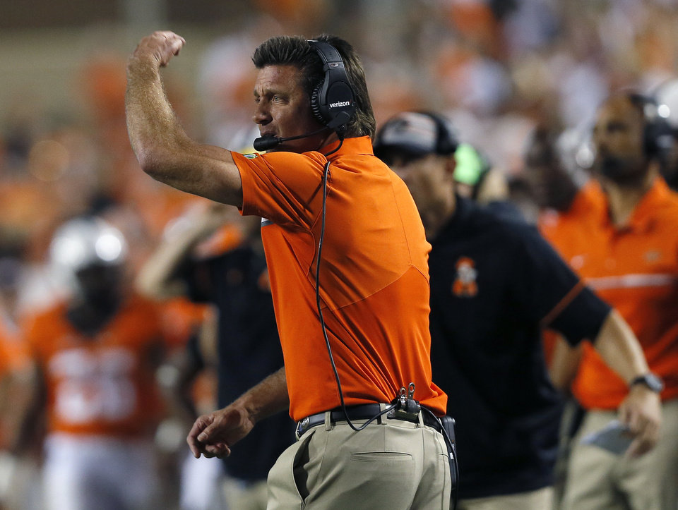 Photo - Oklahoma State head coach Mike Gundy coaches in the fourth quarter during a college football game between the Oklahoma State Cowboys (OSU) and the Pitt Panthers at Boone Pickens Stadium in Stillwater, Okla., Saturday, Sept. 17, 2016. Photo by Sarah Phipps, The Oklahoman
