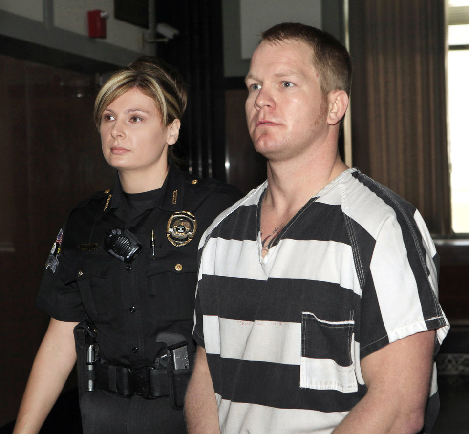 Joshua Rinken being escorted to the courtroom by deputy sheriff Renee Kendrick during his preliminary hearing at the Oklahoma County Courthouse in Oklahoma City Tuesday, May 10, 2011. Photo by Paul B. Southerland, The Oklahoman