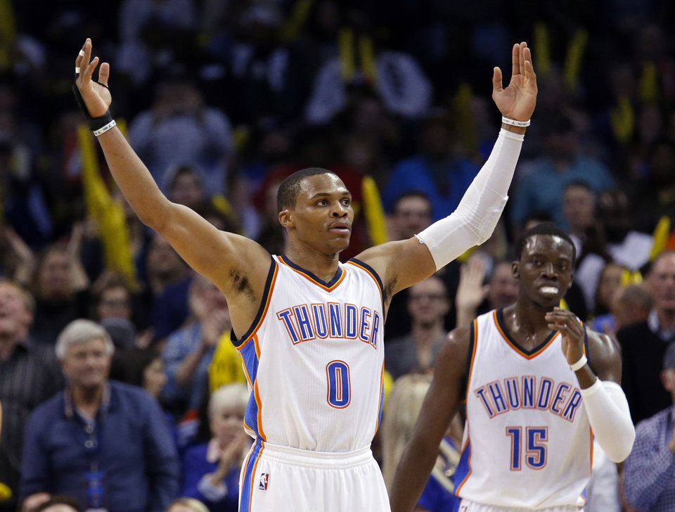 Photo - Oklahoma City's Russell Westbrook (0) celebrates during the NBA game between the Oklahoma City Thunder and the New York Knicks at the Chesapeake Energy Arena in Oklahoma City, Friday, Nov. 28, 2014.  Photo by Sarah Phipps, The Oklahoman