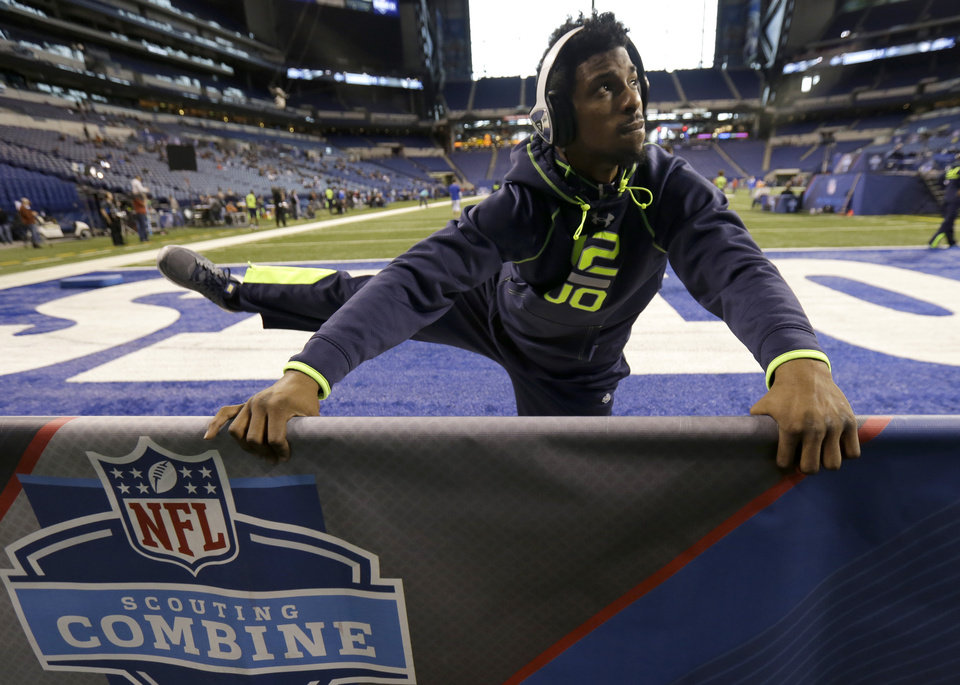 Photo - Oklahoma wide receiver Jalen Saunders stretches at the NFL football scouting combine in Indianapolis, Sunday, Feb. 23, 2014. (AP Photo/Nam Y. Huh)