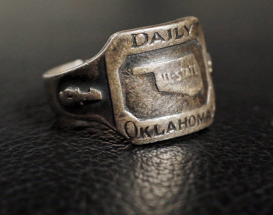 Photo - An All-State high school football ring from 1943, photographed in Oklahoma City, Monday, Dec. 17, 2012. Photo by Nate Billings, The Oklahoman