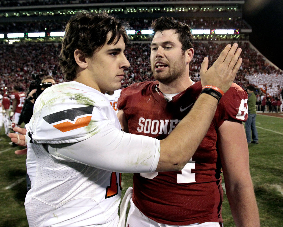 Oklahoma State\'s Clint Chelf (10) and Oklahoma\'s Gabe Ikard (64) greet after the Bedlam college football game in which the University of Oklahoma Sooners (OU) defeated the Oklahoma State University Cowboys (OSU) 51-48 in overtime at Gaylord Family-Oklahoma Memorial Stadium in Norman, Okla., Saturday, Nov. 24, 2012. Photo by Steve Sisney, The Oklahoman