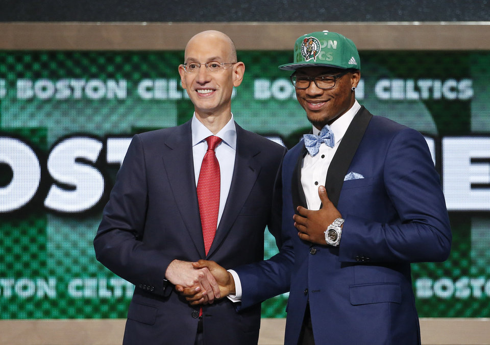 Photo - Oklahoma State's Marcus Smart, right, poses for a photo with NBA commissioner Adam Silver after being selected sixth overall by the Boston Celtics during the 2014 NBA draft, Thursday, June 26, 2014, in New York. (AP Photo/Jason DeCrow)