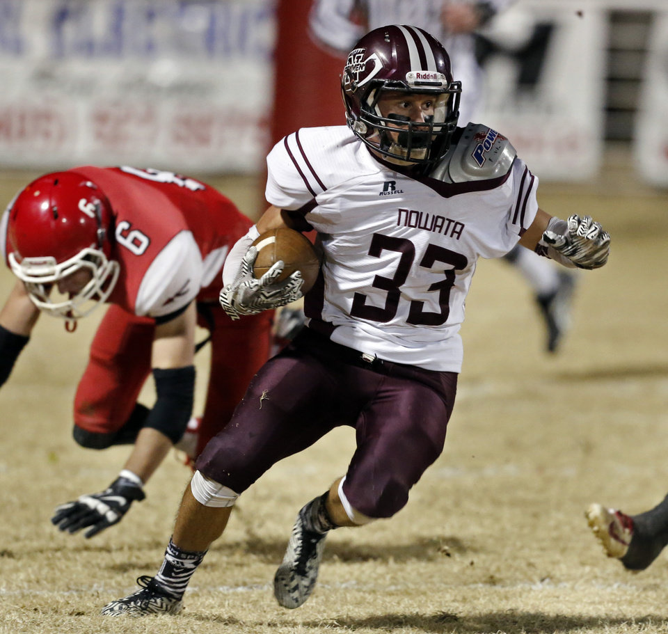 Photo - Nowata's Wyatt Sanders carries as the Nowata Ironmen play the Washington Warriors in high school football on Friday, Nov. 28, 2014 in Washington, Okla. Photo by Steve Sisney, The Oklahoman