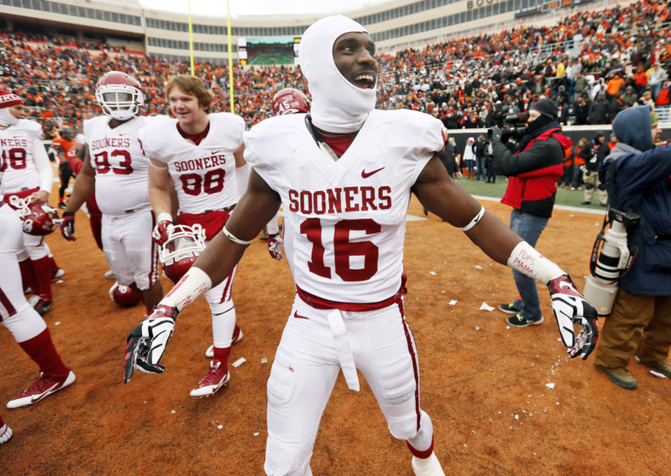 Photo - Oklahoma's Jaz Reynolds (16) yells at the OSU student section after the Bedlam college football game between the Oklahoma State University Cowboys (OSU) and the University of Oklahoma Sooners (OU) at Boone Pickens Stadium in Stillwater, Okla., Saturday, Dec. 7, 2013. OU won, 33-24. Photo by Nate Billings, The Oklahoman