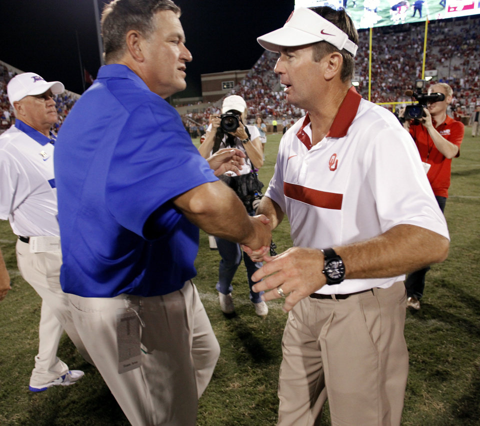 Photo - Tulsa head coach Bill Blankenship and Oklahoma head coach Bob Stoops shake hands after the college football game between the University of Oklahoma Sooners (OU) and the Tulsa University Hurricanes (TU) at the Gaylord Family-Oklahoma Memorial Stadium on Saturday, Sept. 3, 2011, in Norman, Okla.  Photo by Steve Sisney, The Oklahoman ORG XMIT: KOD