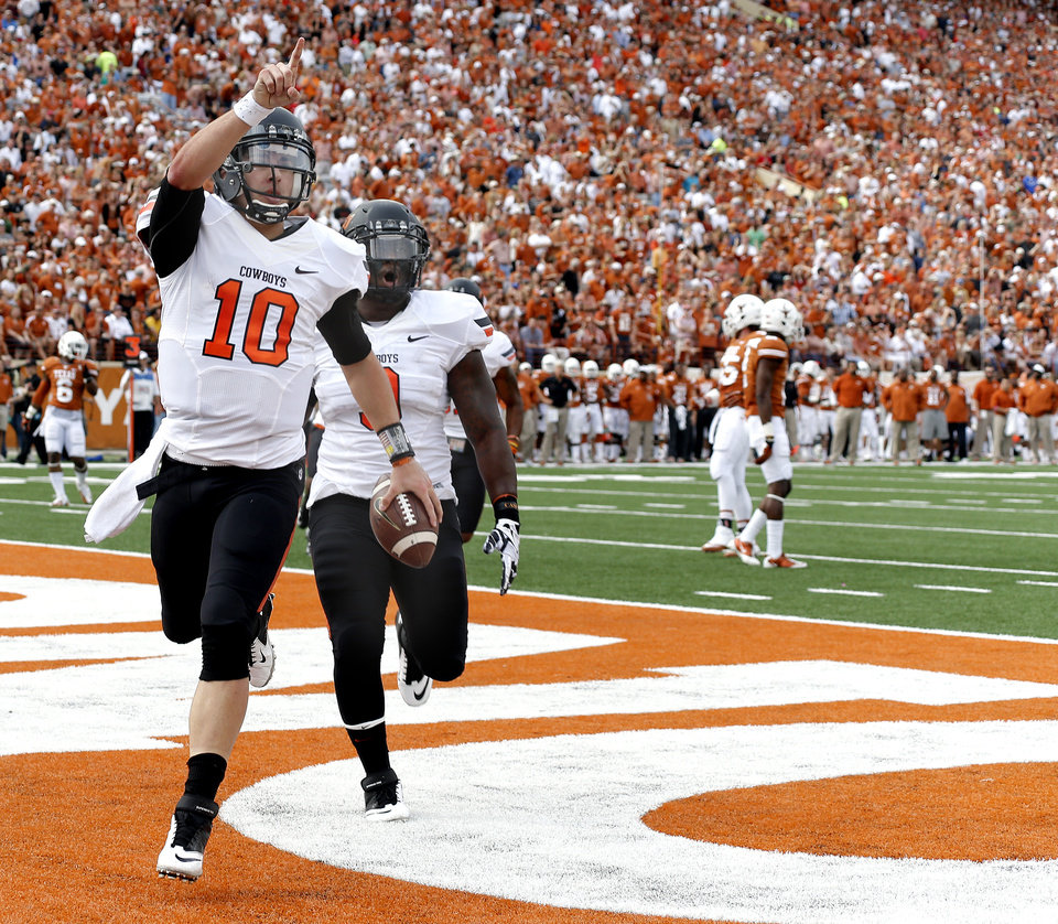 Oklahoma State's Clint Chelf (10) and Kye Staley (9) celebrate as Chelf scores a touchdown in the first quarter of a college football game between the Oklahoma State University Cowboys (OSU) and the University of Texas Longhorns (UT) at Darrell K Royal - Texas Memorial Stadium in Austin, Texas, Saturday, Nov. 16, 2013. Photo by Sarah Phipps The Oklahoman