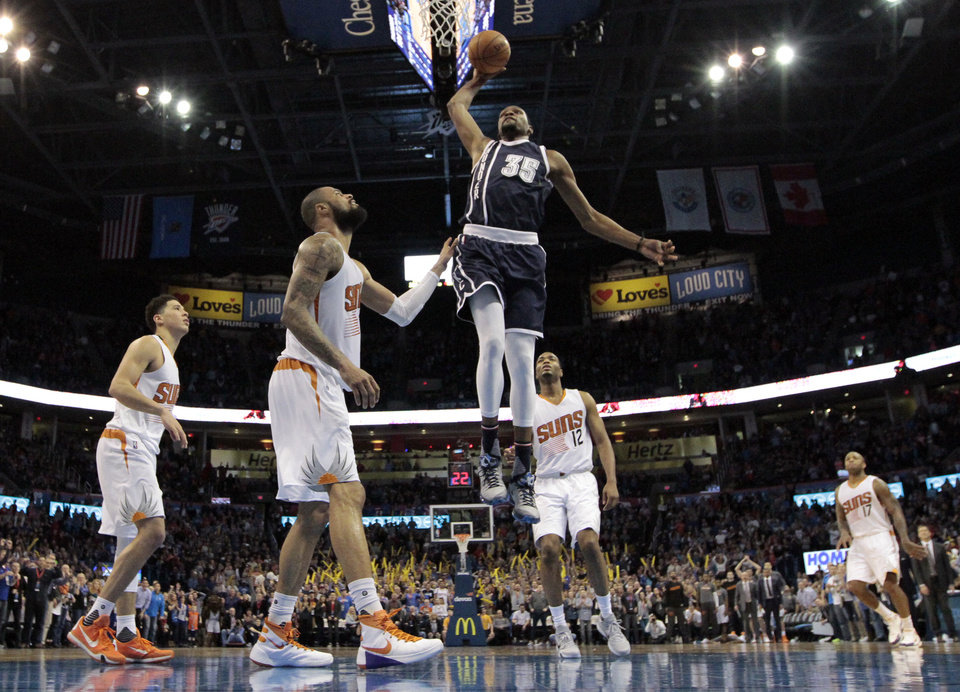 Photo - Oklahoma City Thunder's Kevin Durant (35) dunks the ball in the final minute during the NBA basketball game between the Oklahoma City Thunder and the Phoenix Suns at Chesapeake Energy Arena on Dec. 31, 2015 in Oklahoma City, Okla. Photo by Steve Sisney, The Oklahoman