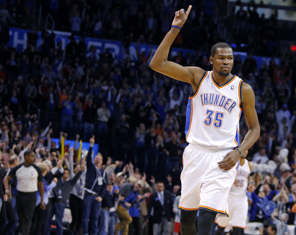Oklahoma City's Kevin Durant (35) celebrates a basket late in an NBA basketball game between the Oklahoma City Thunder and the Portland Trail Blazers at Chesapeake Energy Arena in Oklahoma City, Tuesday, Jan. 21, 2014. Oklahoma City won 105-97. Photo by Bryan Terry, The Oklahoman