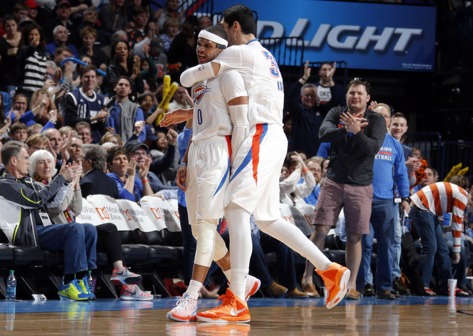 Photo - Oklahoma City's Russell Westbrook (0) and Enes Kanter (34) celebrate a Westbrook 3-point basket during the NBA game between the Oklahoma City Thunder and the Toronto Raptors at the  Chesapeake Energy Arena in Oklahoma City, Sunday, March 8, 2015. Photo by Sarah Phipps, The Oklahoman