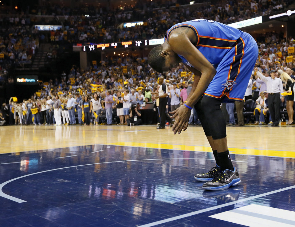 Photo - Oklahoma City's Kevin Durant (35) leans over and pauses before walking to the bench when a timeout is called in the final minute of Game 3 in the second round of the NBA basketball playoffs between the Oklahoma City Thunder and Memphis Grizzles at the FedExForum in Memphis, Tenn.,  Saturday, May 11, 2013. Memphis won, 87-81. Photo by Nate Billings, The Oklahoman