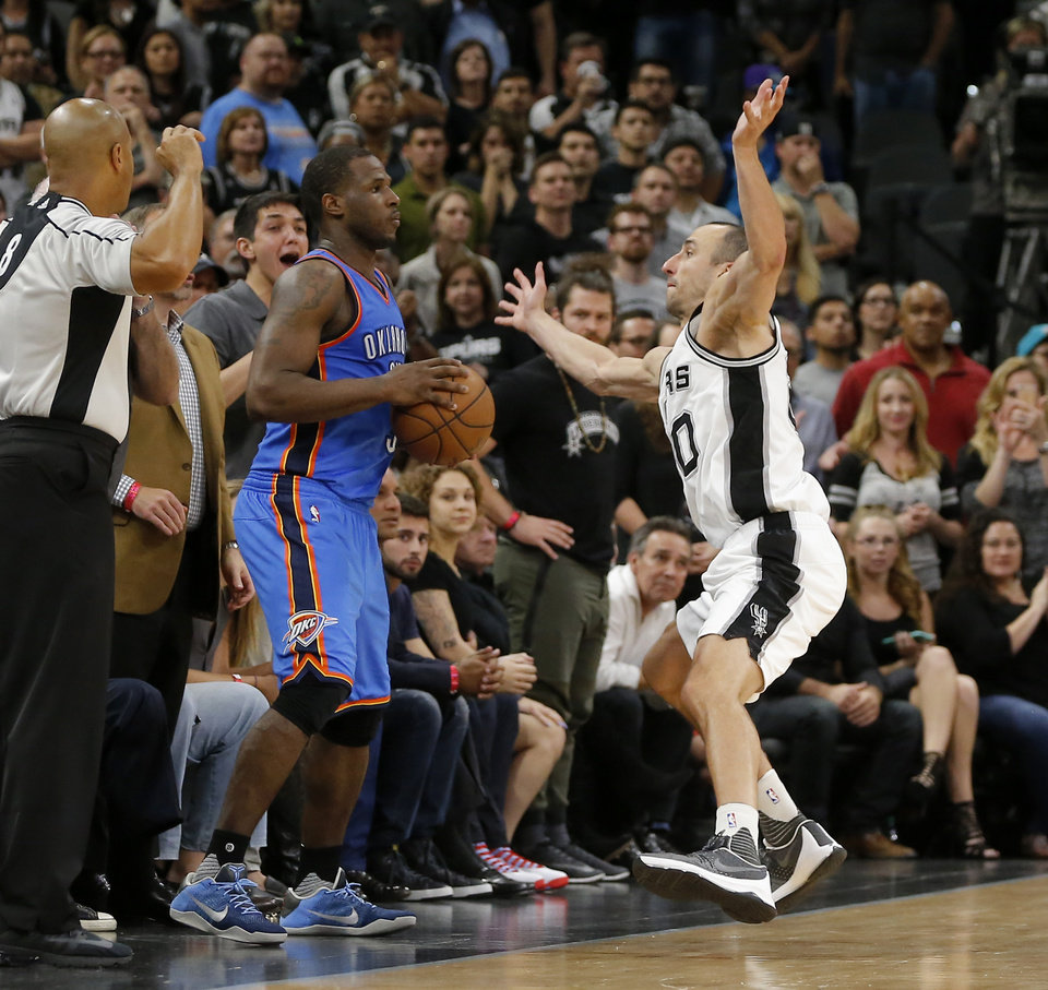 Photo - Oklahoma City's Dion Waiters (3) tries to throw the ball in as San Antonio's Manu Ginobili (20) defends during Game 2 of the second-round series between the Oklahoma City Thunder and the San Antonio Spurs in the NBA playoffs at the AT&T Center in San Antonio, Monday, May 2, 2016. Oklahoma City won 98-97. Photo by Bryan Terry, The Oklahoman