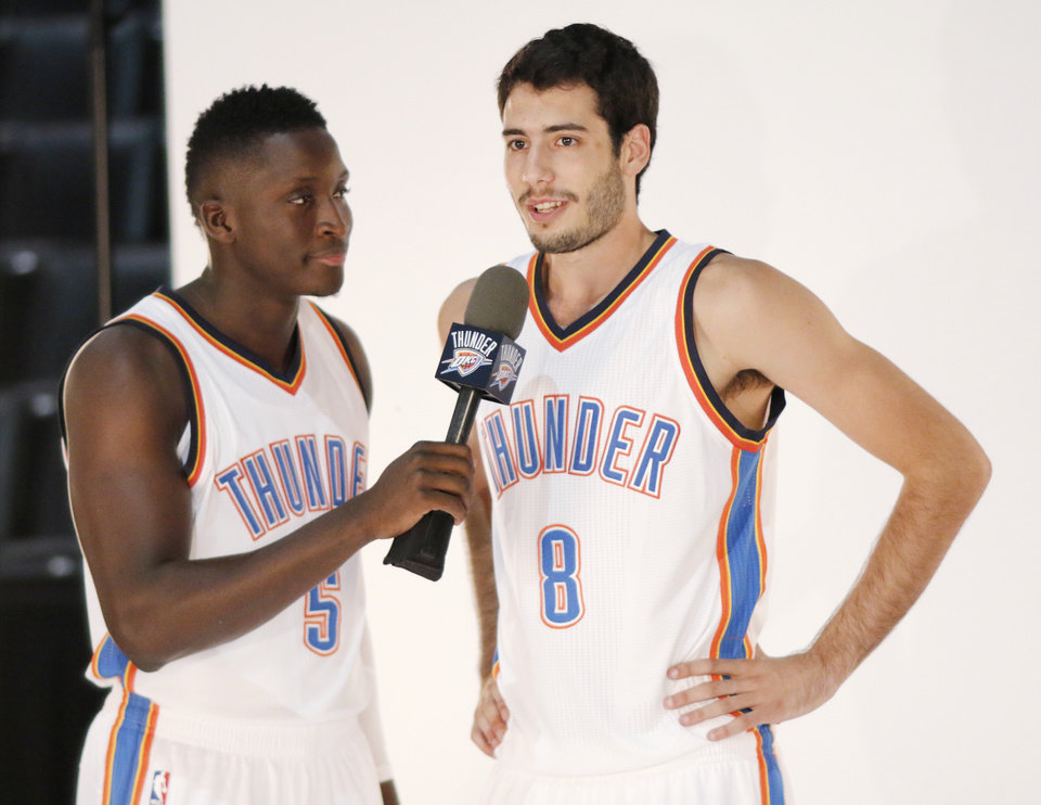 Photo - Victor Oladipo interrupts a shoot of Alex Abrines to ask a question during the Oklahoma City Thunder media day, Friday, September 23, 2016. Photo by Doug Hoke, The Oklahoman