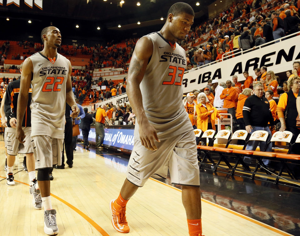 Photo - Oklahoma State's Marcus Smart (33) and Markel Brown (22) leave the court after a men's college basketball game between Oklahoma State University (OSU) and Gonzaga at Gallagher-Iba Arena in Stillwater, Okla., Monday, Dec. 31, 2012. Gonzaga won, 69-68. Photo by Nate Billings, The Oklahoman