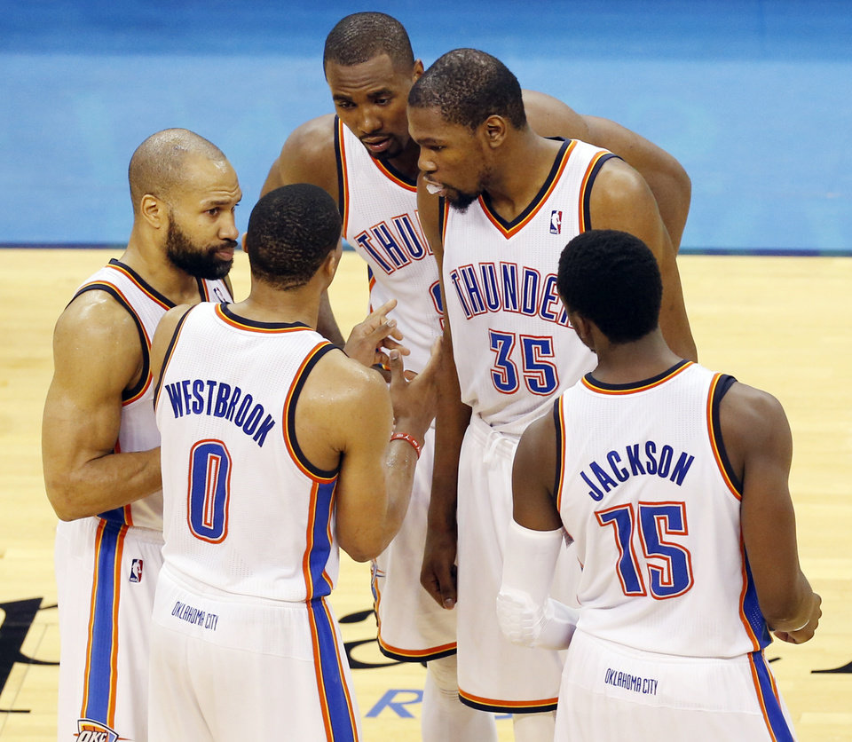 Photo - From left, Oklahoma City's Derek Fisher (6), Russell Westbrook (0), Serge Ibaka (9), Kevin Durant (35) and Reggie Jackson (15) talk before the start of overtime during Game 6 of the Western Conference Finals in the NBA playoffs between the Oklahoma City Thunder and the San Antonio Spurs at Chesapeake Energy Arena in Oklahoma City, Saturday, May 31, 2014. The Spurs won 112-107 in overtime. Photo by Nate Billings, The Oklahoman