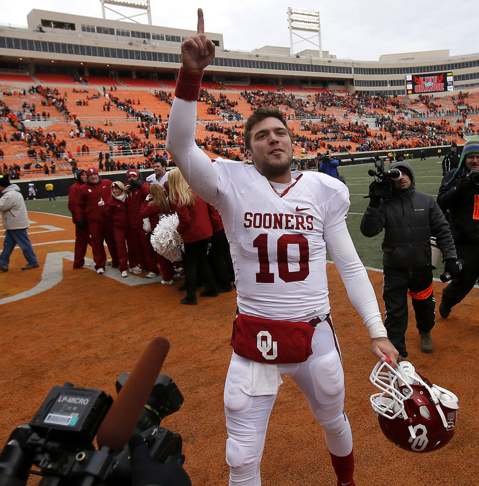 Photo - Oklahoma's Blake Bell (10) celebrates after  the Bedlam college football game between the Oklahoma State University Cowboys (OSU) and the University of Oklahoma Sooners (OU) at Boone Pickens Stadium in Stillwater, Okla., Saturday, Dec. 7, 2013. Oklahoma won 33-24. Photo by Bryan Terry, The Oklahoman