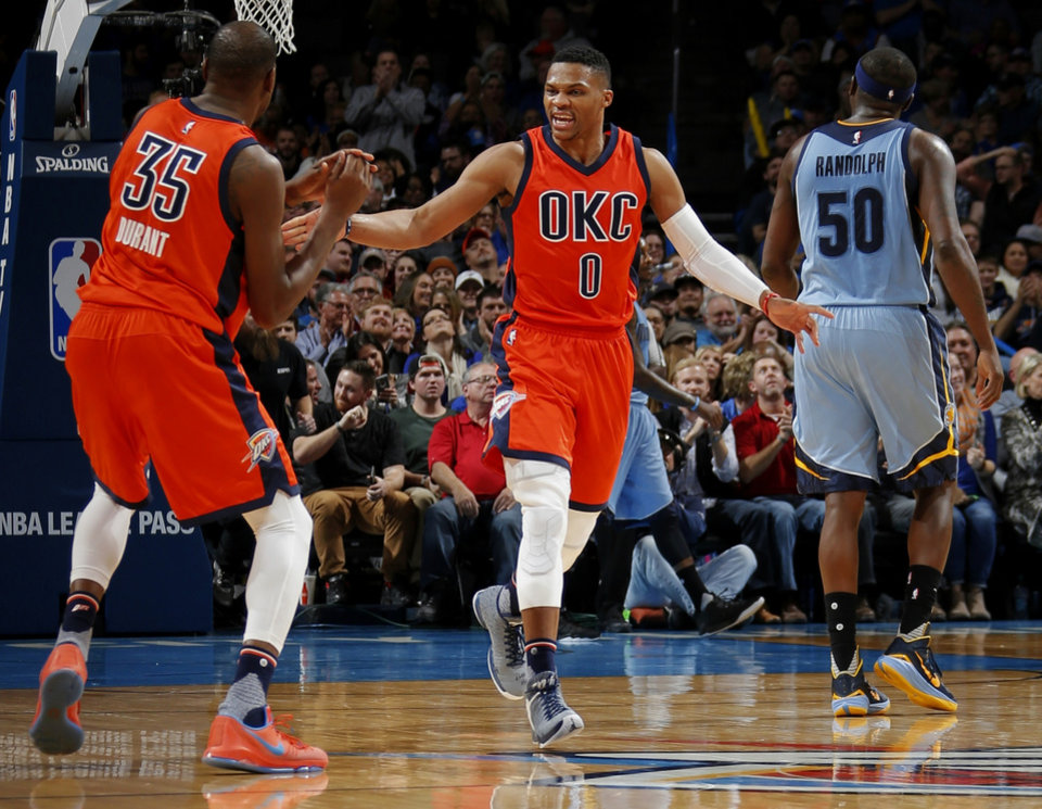 Photo - Oklahoma City's Kevin Durant and Russell Westbrook celebrate beside Memphis' Zach Randolph during an NBA basketball game between the Oklahoma City Thunder and the Memphis Grizzlies at Chesapeake Energy Arena in Oklahoma City, Wednesday, Jan. 6, 2016.  Photo by Bryan Terry, The Oklahoman