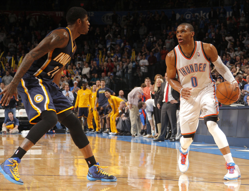 Oklahoma City\'s Russell Westbrook (0) tries to get by Indiana\'s Paul George (24) during the NBA game between the Indiana Pacers and the Oklahoma City Thunder at the Chesapeake Energy Arena Sunday,Dec. 9, 2012. Photo by Sarah Phipps, The Oklahoman