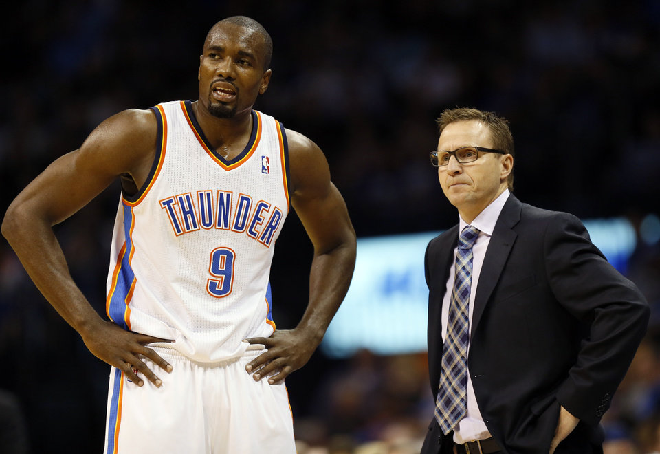 Oklahoma City\'s Serge Ibaka (9) talks to head coach Scott Brooks during an NBA basketball game between the Memphis Grizzlies and the Oklahoma City Thunder at Chesapeake Energy Arena in Oklahoma City, Friday, Feb. 28, 2014. Photo by Nate Billings, The Oklahoman