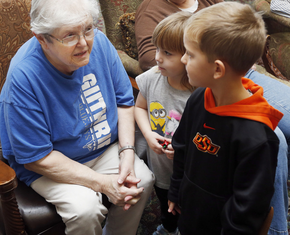 Photo -  Martha Evans, left, talks with Kadence Nitzel, 4, and Ethan Dayton, 4, at Willow Creek Nursing Home in Guthrie, Okla., Wednesday, Nov. 11, 2015. Photo by Nate Billings, The Oklahoman