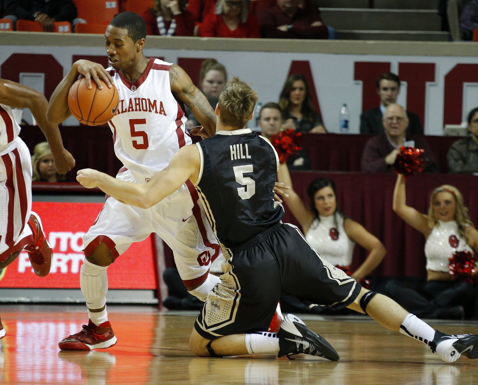 Photo - Oklahoma's Je'lon Hornbeak (5) goes past Idaho's Connor Hill (5) during a college basketball game between the University of Oklahoma Sooners and the Idaho Vandals at Lloyd Noble Center in Norman, Okla., on Wednesday, Nov. 13, 2013. Wednesday, Nov. 13, 2013. Photo by Bryan Terry, The Oklahoman