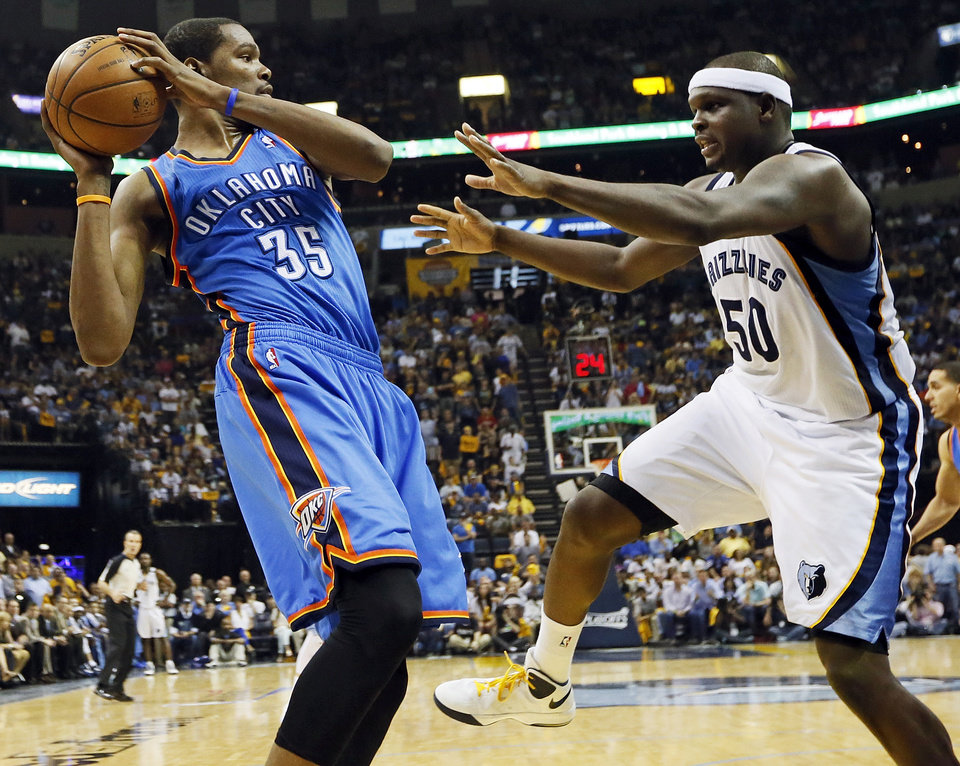 Photo - Oklahoma City's Kevin Durant (35) keeps the ball away from Memphis' Zach Randolph (50) during Game 3 in the second round of the NBA basketball playoffs between the Oklahoma City Thunder and Memphis Grizzles at the FedExForum in Memphis, Tenn., Saturday, May 11, 2013. Memphis won, 87-81. Photo by Nate Billings, The Oklahoman