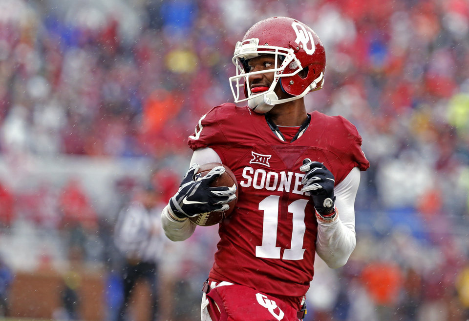Photo - Oklahoma's Dede Westbrook (11) scores a touchdowm during the Bedlam college football game between the Oklahoma Sooners (OU) and the Oklahoma State Cowboys (OSU) at Gaylord Family - Oklahoma Memorial Stadium in Norman, Okla., Saturday, Dec. 3, 2016. Photo by Steve Sisney, The Oklahoman