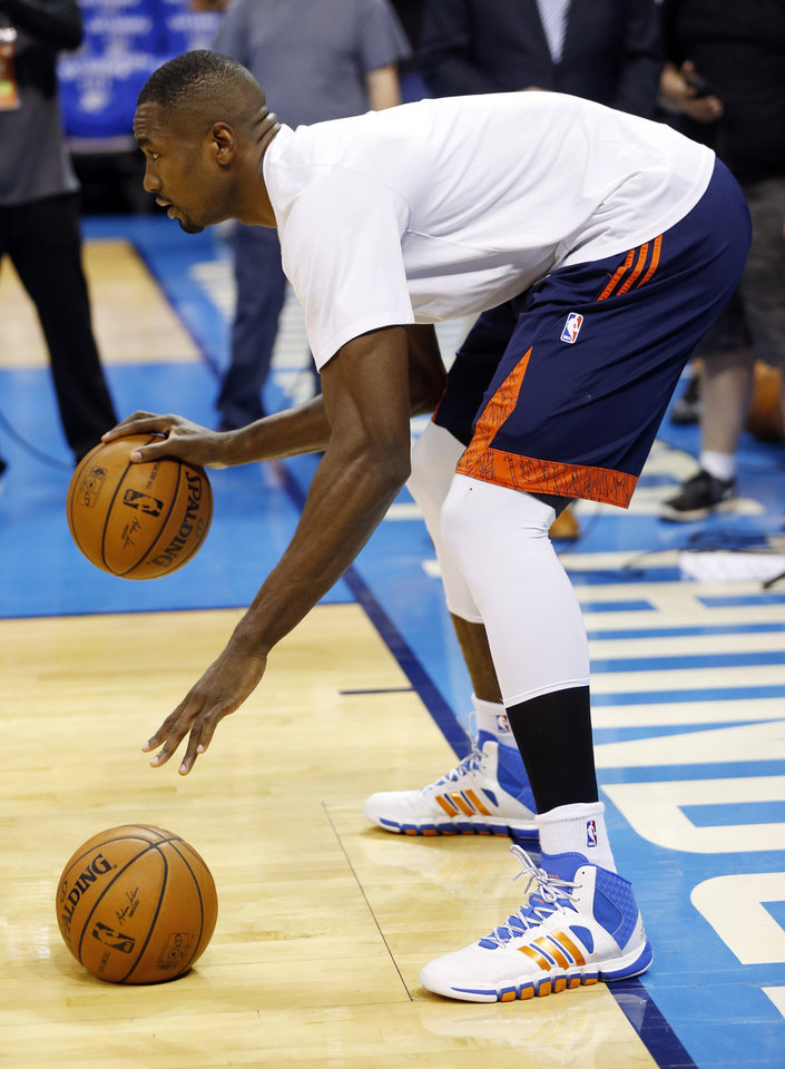 Photo - Oklahoma City's Serge Ibaka (9) warms up before Game 3 of the Western Conference Finals in the NBA playoffs between the Oklahoma City Thunder and the San Antonio Spurs at Chesapeake Energy Arena in Oklahoma City, Sunday, May 25, 2014. Photo by Nate Billings, The Oklahoman