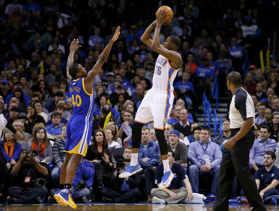 Photo - Oklahoma City's Kevin Durant (35) shoots over Golden State's Harrison Barnes (40) during an NBA basketball game between the Oklahoma City Thunder and the Golden State Warriors at Chesapeake Energy Arena in Oklahoma City, Friday, Jan. 17, 2014. Oklahoma City won 127-121. Photo by Bryan Terry, The Oklahoman
