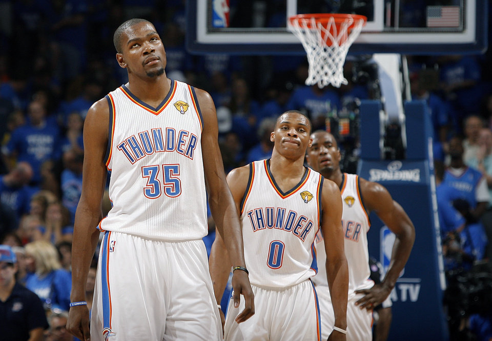 Photo - Oklahoma City's Kevin Durant (35), Russell Westbrook (0) and Serge Ibaka (9) react during Game 2 of the NBA Finals between the Oklahoma City Thunder and the Miami Heat at Chesapeake Energy Arena in Oklahoma City, Thursday, June 14, 2012. Photo by Sarah Phipps, The Oklahoman