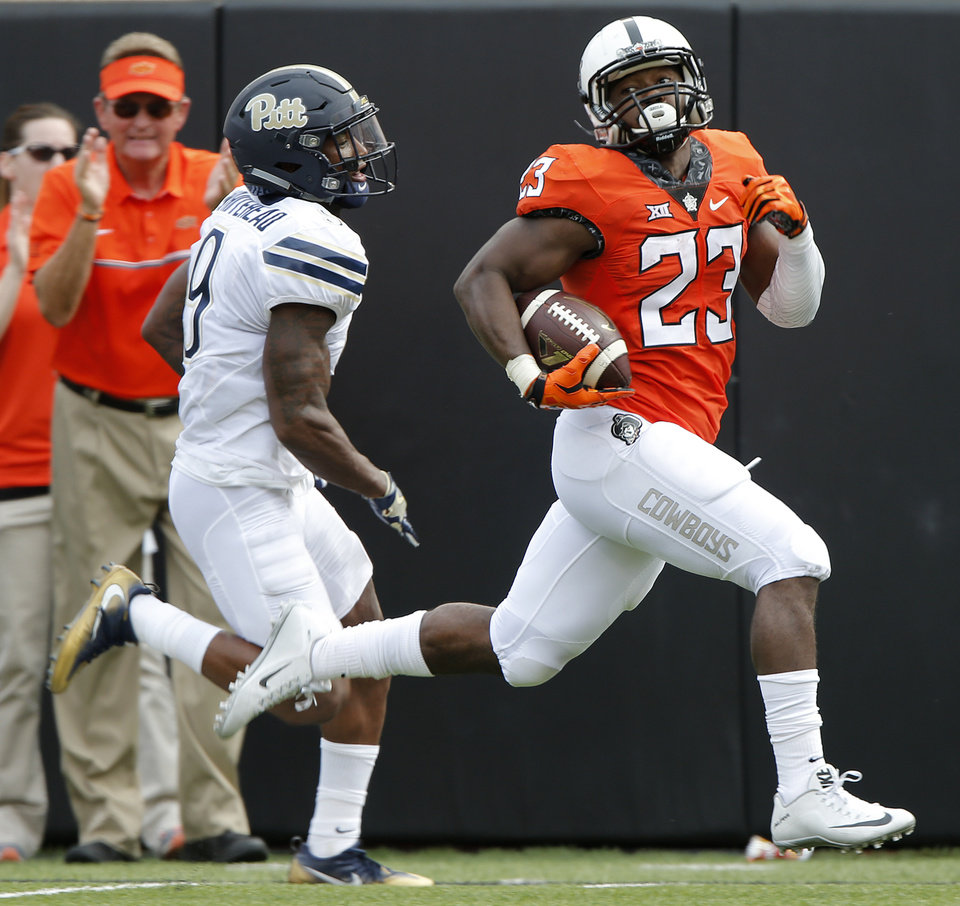 Photo - Oklahoma State's Rennie Childs (23) runs for a touchdown past Pittsburgh's Jordan Whitehead (9) during a college football game between the Oklahoma State Cowboys (OSU) and the Pitt Panthers at Boone Pickens Stadium in Stillwater, Okla., Saturday, Sept. 17, 2016. Photo by Chris Landsberger, The Oklahoman