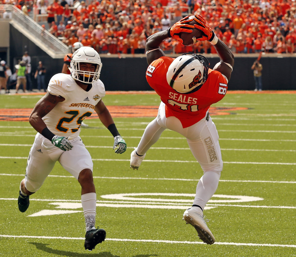 Photo - Oklahoma State's Jhajuan Seales scores on a pass during the college football game between the Oklahoma State Cowboys (OSU) and the Southeastern Louisiana Lions at Boone Pickens Stadium in Stillwater, Okla., Saturday, Sept. 12, 2015. Photo by Steve Sisney, The Oklahoman