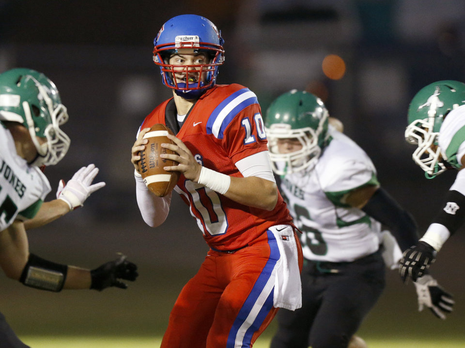 Austin Brooks of Oklahoma Christian School (OCS) drops back to pass against Jones during a high school football game in Edmond, Friday, September 14, 2012. Photo by Bryan Terry, The Oklahoman