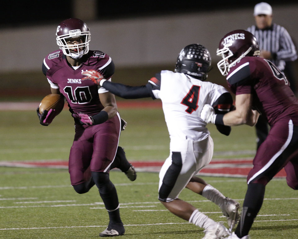 Photo - Jenks (10) Steven Parker gets around Westmoore's Kiante Channel (4) on the block by Riley Waldie (47) during the 6A high school playoff game between Westmoore and Jenks at Yukon High School Friday November 29, 2013. Photo by Doug Hoke, The Oklahoman