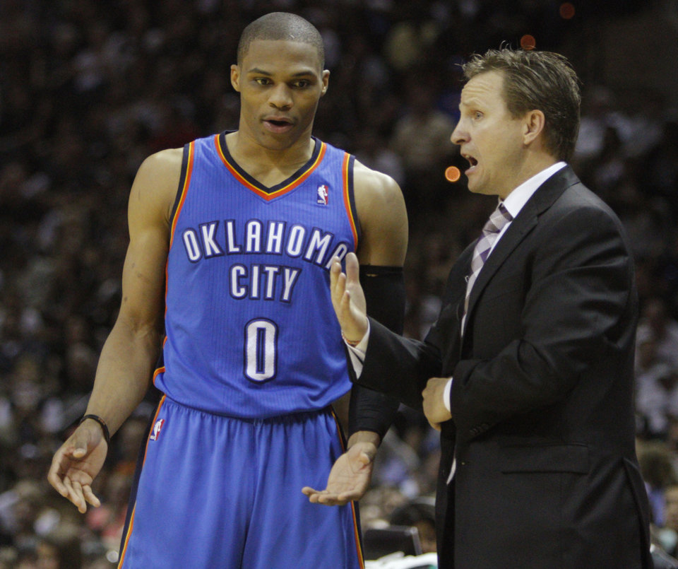 Oklahoma City coach Scott Brooks talks with Oklahoma City\'s Russell Westbrook (0) during Game 1 of the Western Conference Finals between the Oklahoma City Thunder and the San Antonio Spurs in the NBA playoffs at the AT&T Center in San Antonio, Texas, Sunday, May 27, 2012. Oklahoma City lost 101-98. Photo by Bryan Terry, The Oklahoman