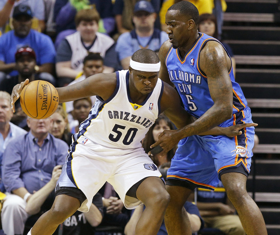Memphis\' Zach Randolph (50) works against Oklahoma City\'s Kendrick Perkins (5) during Game 4 in the first round of the NBA playoffs between the Oklahoma City Thunder and the Memphis Grizzlies at FedExForum in Memphis, Tenn., Saturday, April 26, 2014. Photo by Bryan Terry, The Oklahoman