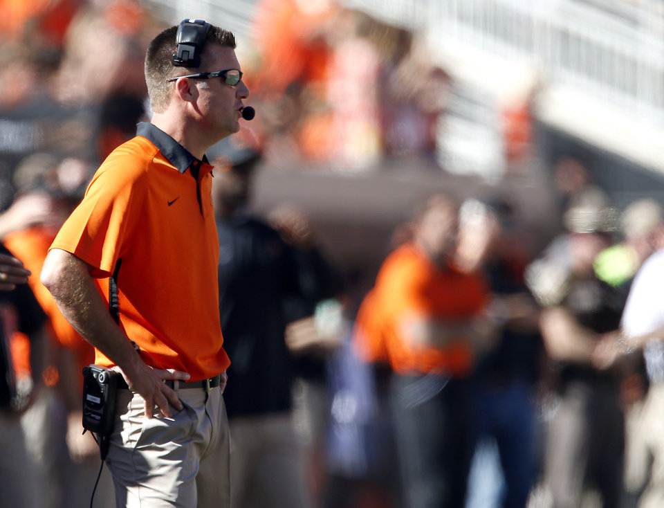 Photo - Oklahoma State head coach Mike Gundy coaches during a college football game between Oklahoma State University (OSU) and Iowa State University (ISU) at Boone Pickens Stadium in Stillwater, Okla., Saturday, Oct. 20, 2012. Photo by Sarah Phipps, The Oklahoman