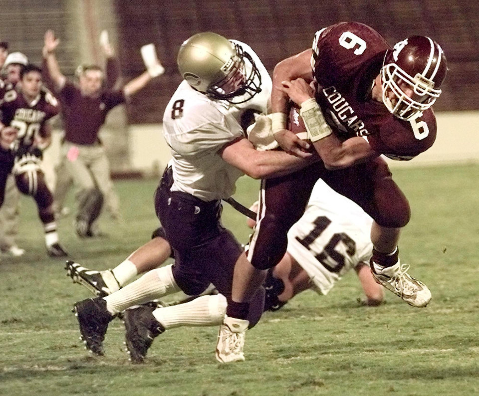 Chickasha's Steven Elrod, left, tries to strip the ball from Ada's Brian Odom during a 1998 game in Norman. PHOTO FROM THE OKLAHOMAN'S ARCHIVES