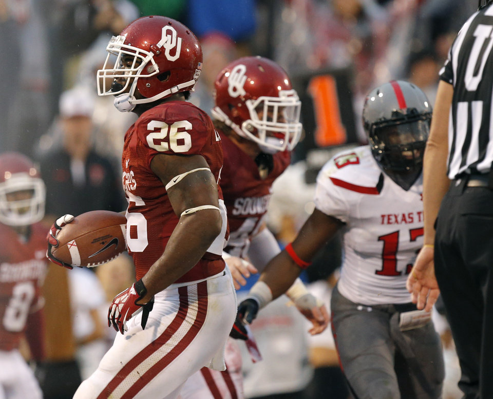 Oklahoma's Damien Williams (26) scores a touchdown during a college football game between the University of Oklahoma Sooners (OU) and the Texas Tech Red Raiders at Gaylord Family-Oklahoma Memorial Stadium in Norman, Okla., on Saturday, Oct. 26, 2013. Oklahoma won 38-30. Photo by Bryan Terry, The Oklahoman
