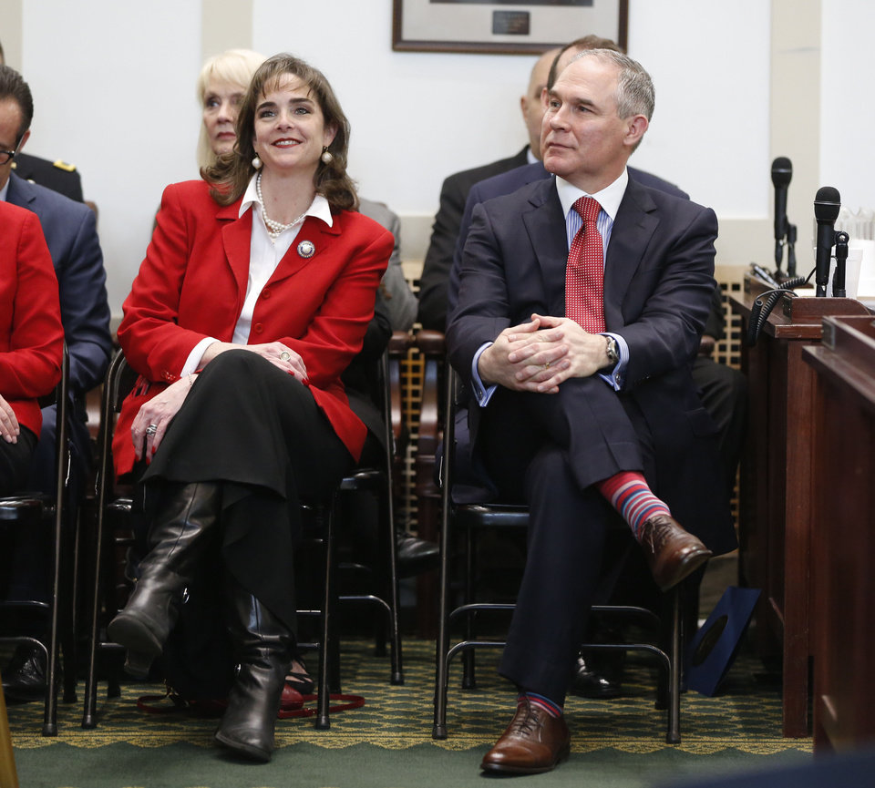 Photo - Oklahoma Labor Commissioner Melissa Houston and Oklahoma Attorney General and EPA Administrator appointee Scott Pruitt listen to the State of the State address by Governor Mary Fallin on the floor of the House of Representatives at the State Capitol in Oklahoma City, Okla. Monday, Feb. 6, 2017.  Photo by Paul Hellstern, The Oklahoman