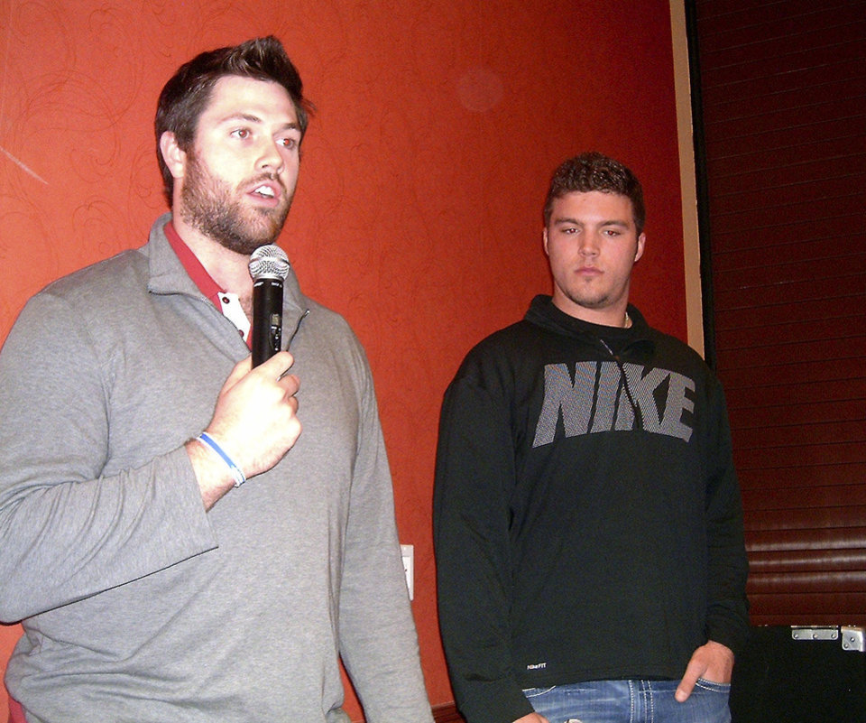 University of Oklahoma football players Gabe Ikard, left, and Blake Bell talk to young men attending the  Catholic Men's Conference on Feb. 16 in Norman.  Photos by Steve Gust for The Oklahoman